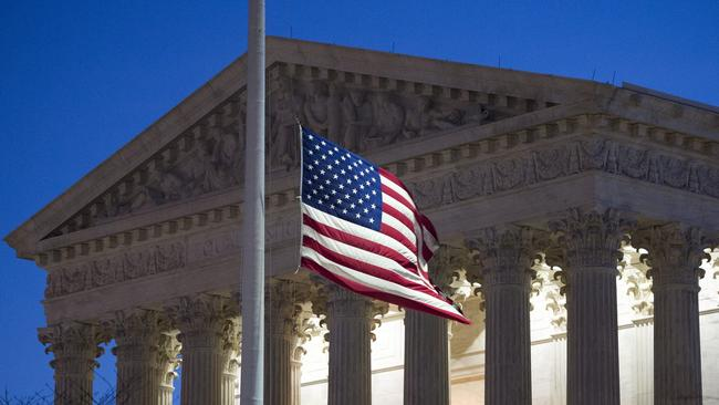 Flags were hardly lowered to half-staff before the battle over Scalia's replacement. [Photo: Chicago Tribune]